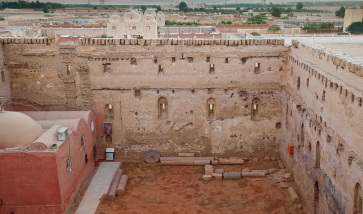 Main Courtyard looking west with Church of the Virgin Mary in the foreground